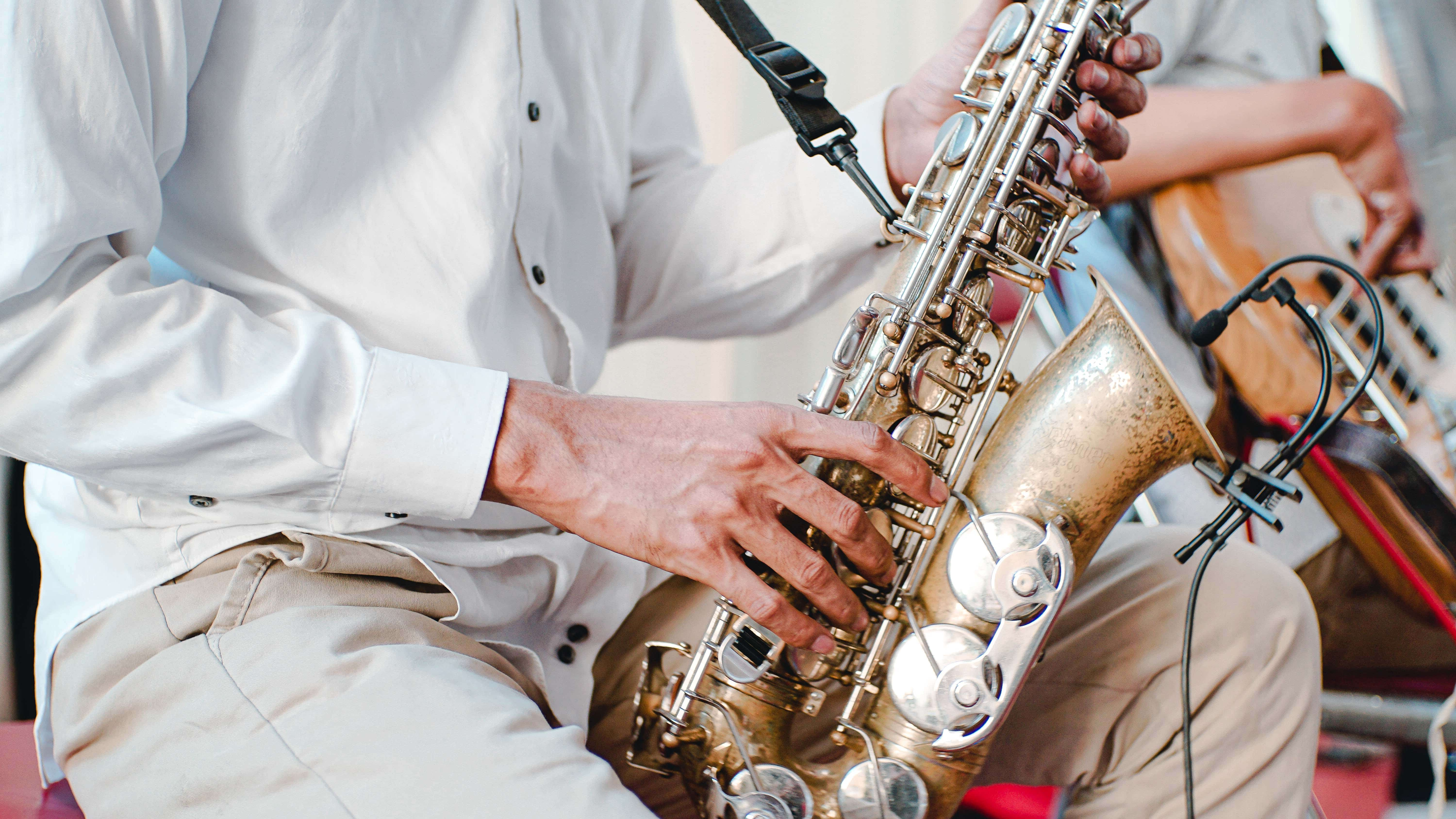 Picture of a man playing saxophone