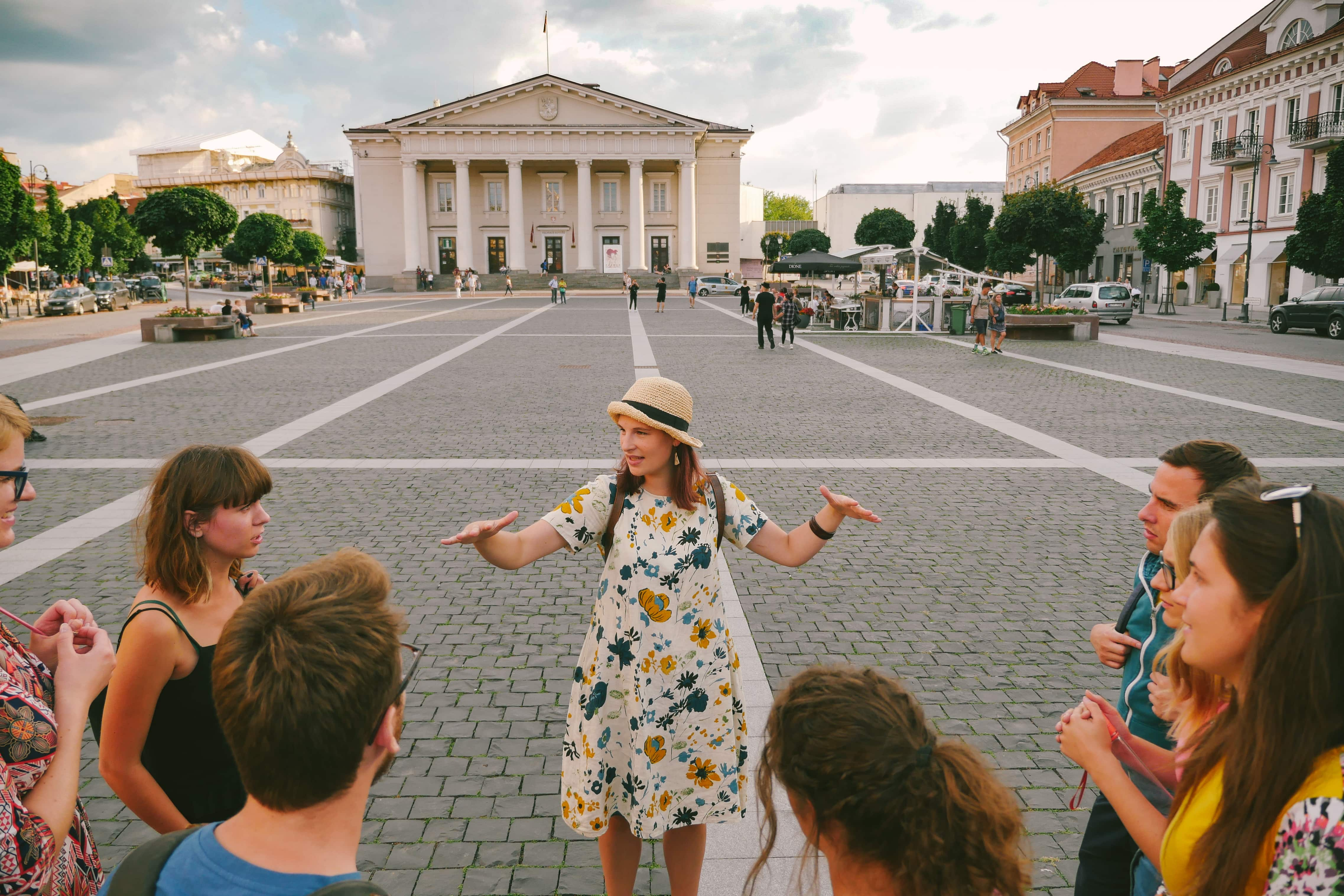 Picture of our tour guide with a group of tourists in Vilnius