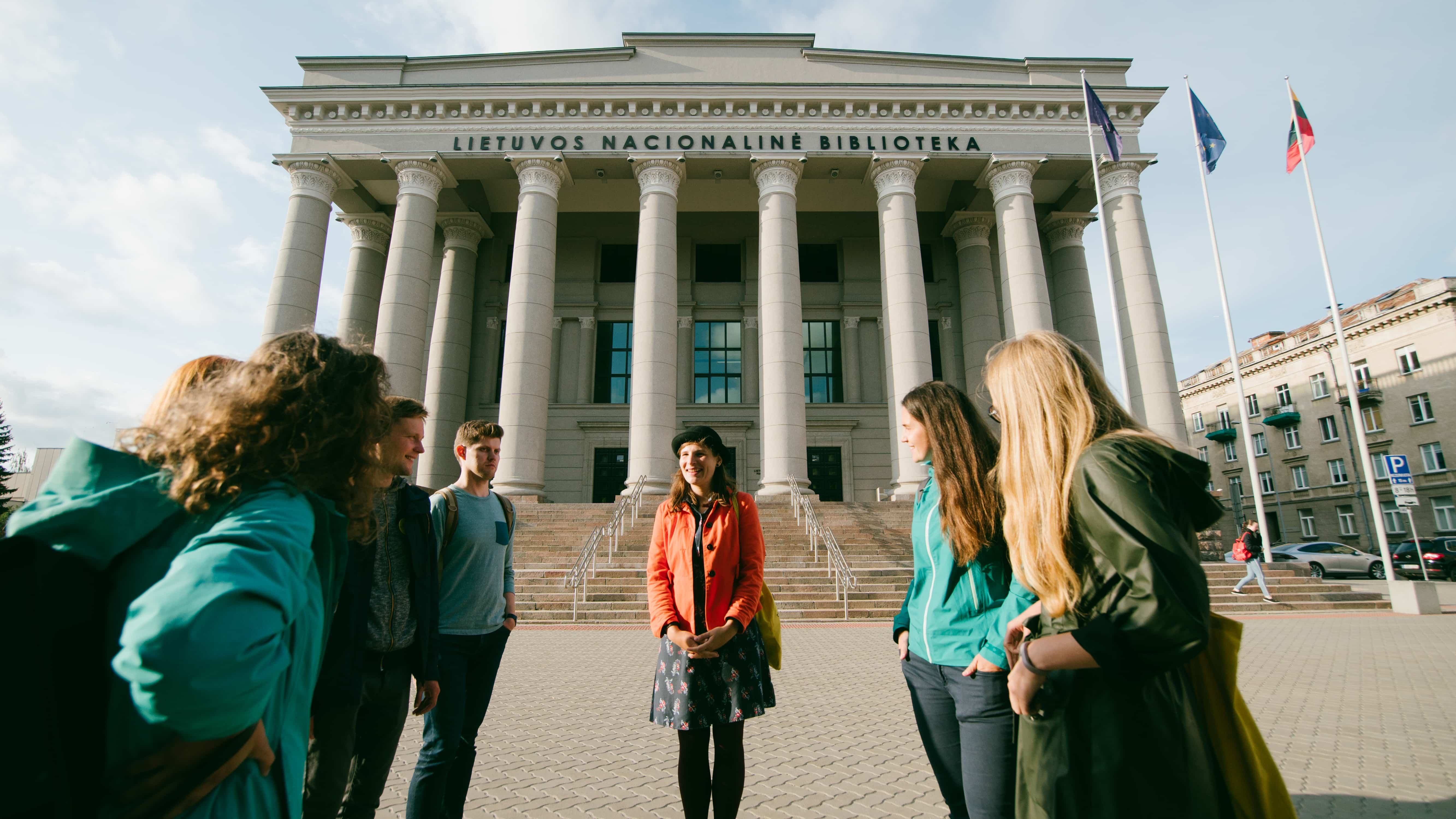 Tourists on Vilnius city tour in front of Lithuanian National Library