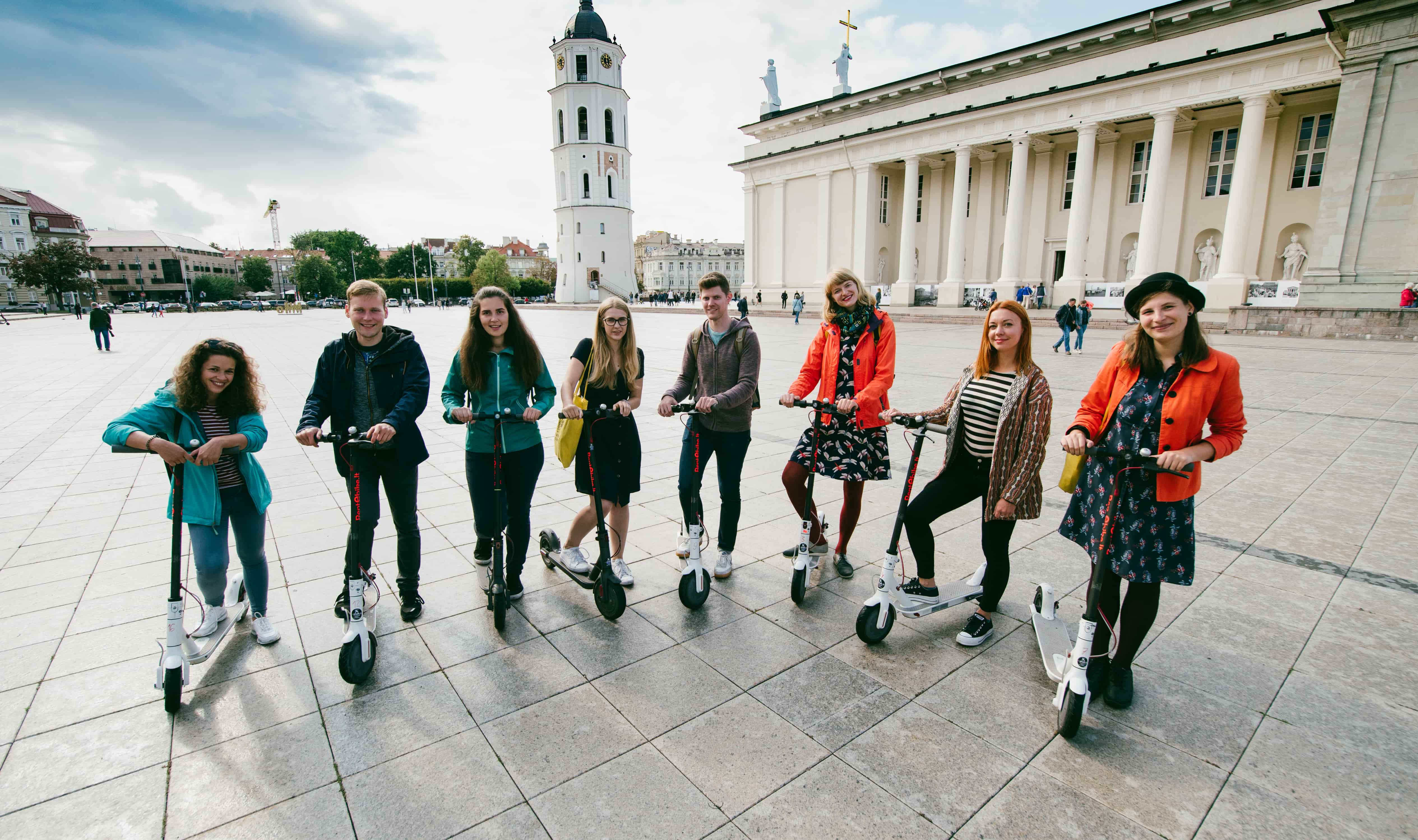 Our tour guides on electric scooters