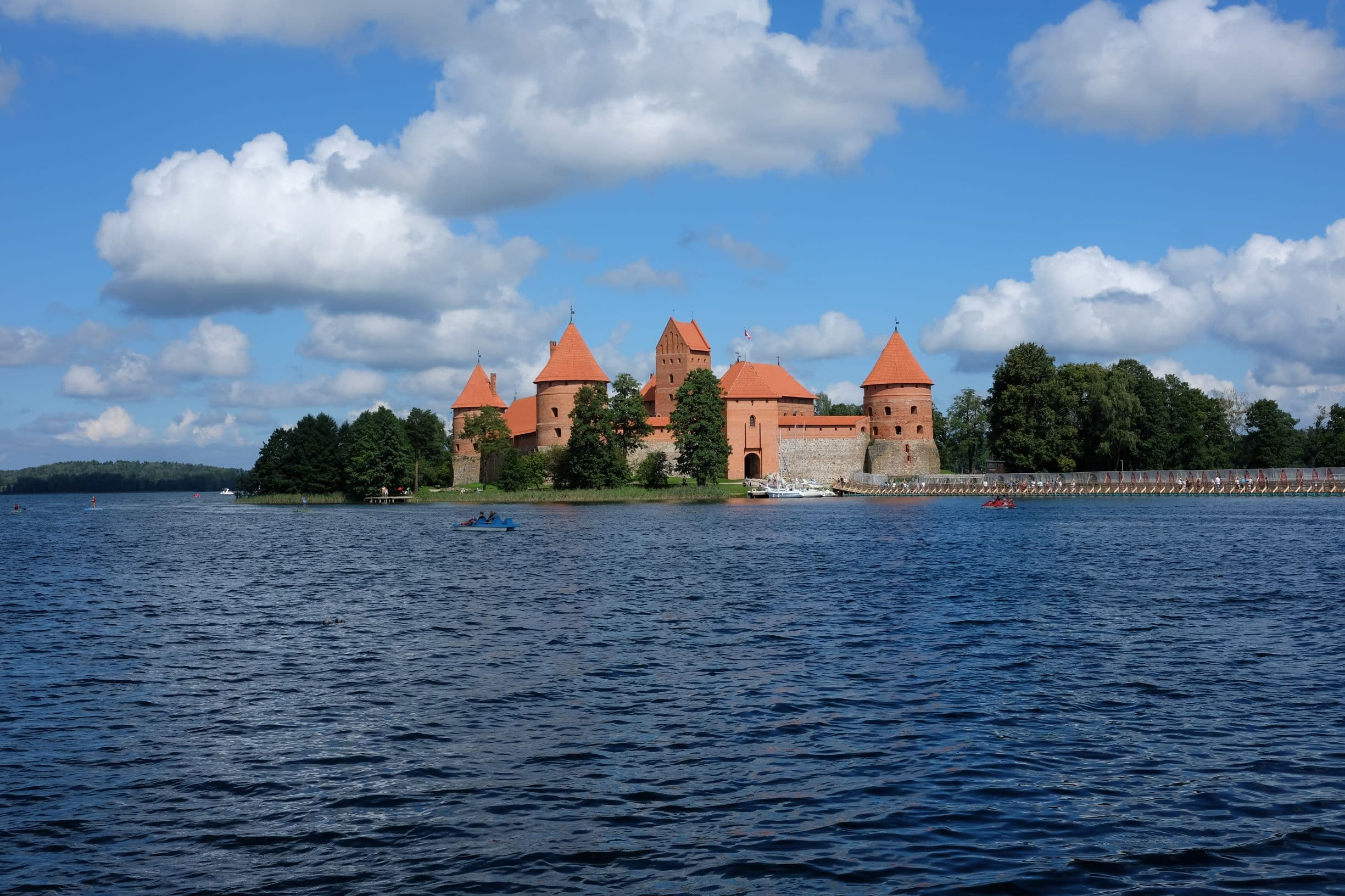 One of the must sees in Lithuania - red brick Trakai castle in the middle of the lake