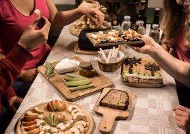 A group tasting food on a private Vilnius city tour around Old Town & Uzupis