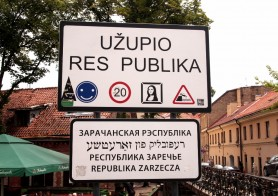 A sign in front of the entrance to Uzupis Republic in Vilnius